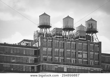 Water Towers On A Building Rooftop, New York.