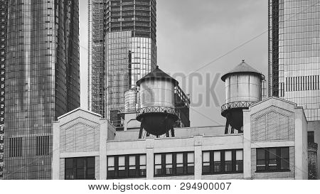 Black And White Picture Of A Water Towers On A Building Rooftop, New York City, Usa.