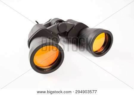 Black Binoculars With Orange Lens Isolated On White Background