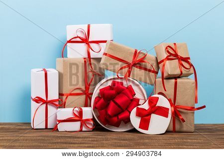 Festive Gift Box On Blue Background. Festive Greeting Card.