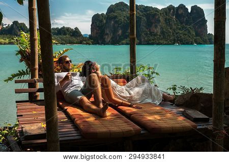 Loving Couple Resting In Asia. A Young Couple Travels To Exotic Countries. Man And Woman At The Reso