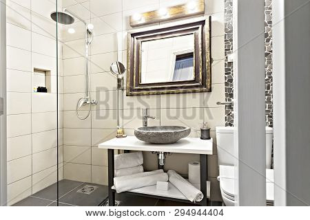 Modern Contemporary Interior Bathroom With Sink And Mirror, Glass Walk In Shower With Marble Tile Su