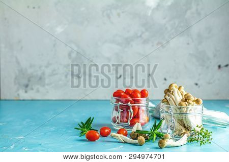 Clump Of Shimeji Mushroom And Cherry Tomatoes In Jars