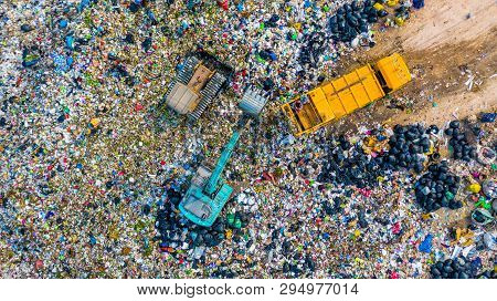 Garbage Pile  In Trash Dump Or Landfill, Aerial View Garbage Trucks Unload Garbage To A Landfill,  G