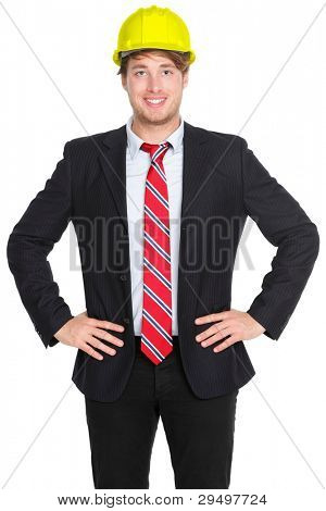 Engineer or architect man in suit wearing helmet isolated on white background. Young male professional smiling happy and confident