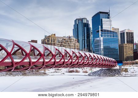 Calgary, Alberta, Canada - March 19, 2013: The Peace Bridge Over The Frozen Bow River In Downtown Ca