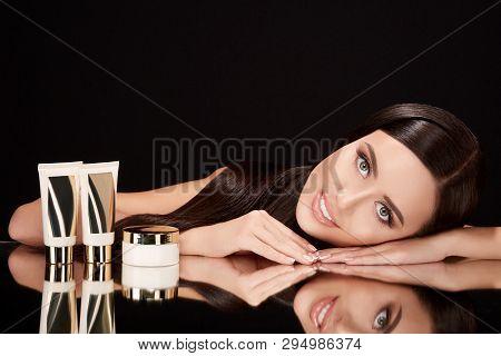 Beautiful Woman On Black Glass With Creams