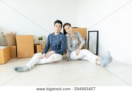 Happy Asian Young Couple Moving In New House.happy Married People Buy A New Apartment To Start New L
