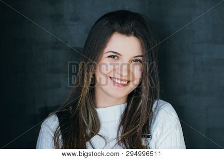Happy Young Woman Portrait. Smiling Beautiful Brunette With Long Hair Looking At Camera. Carefree Yo