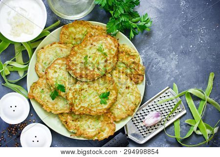 Pan Fried Zucchini Fritters, Traditional Flat Zucchini Pancakes With Garlic And Green Parsley