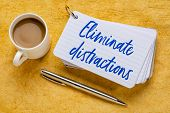 Eliminate distractions - handwriting on a stack of index cards with a cup of coffee and  a pen against yellow textured paper poster