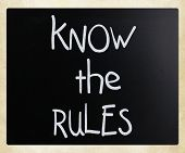 """Know the rules"" handwritten with white chalk on a blackboard poster"