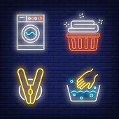 Washing machine, linen, hand washing and clothes peg neon signs set. Laundry service and housework design. Night bright neon sign, colorful billboard, light banner. Vector illustration in neon style. poster