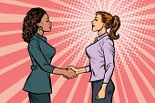 two businesswomen shaking hands. Pop art retro vector illustration vintage kitsch 50s 60s poster