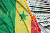 Senegal flag and chart falling US dollar position with a fan of dollar bills poster