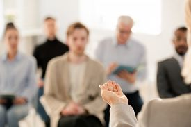 Hand of confident professional business coach during explanation of lecture point to students at seminar or training