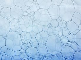 Many Foam Blue Texture Soap Bubbles On The Water Abstract Background
