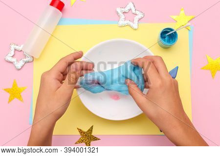 How To Make Slime At Home. Children Art Project. The Concept Of Diy. Kids Hands Make Blue Slime With