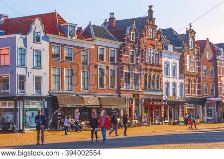 Delft, Netherlands - April 8, 2016: Colorful Street View With Shops And People