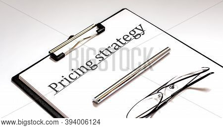 Pricing Strategy Text Written On Paper With Pen And Glasses