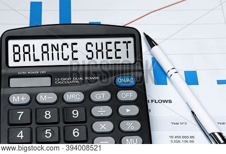 Calculator With The Word Balance Sheet On The Display. Money, Finance And Business Concept