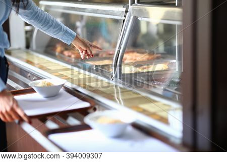 Woman In Cafe Points To Dinner Dish On Salad Tray. Self Service In Bistro And Cafe Concept