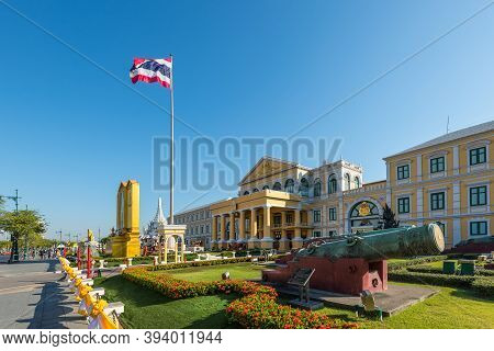Bangkok, Thailand - December 6, 2019: View of the Ministry of Defence headquarters of Thailand with old bronze cannons in the foreground in Bangkok.