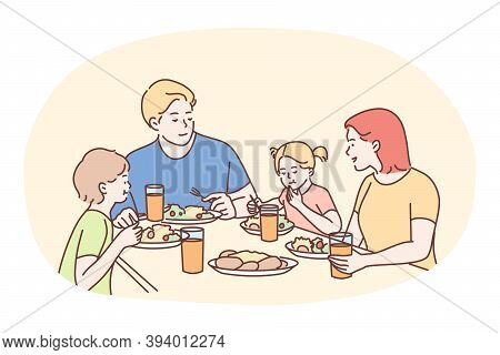 Happy Family Having Dinner Or Breakfast Together At Home. Smiling Family Father Mother And Children