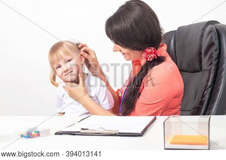 Childrens Otolaryngologist Examines The Ear Of A Little Girl 3-4 Years Who Has Pain And Inflammation