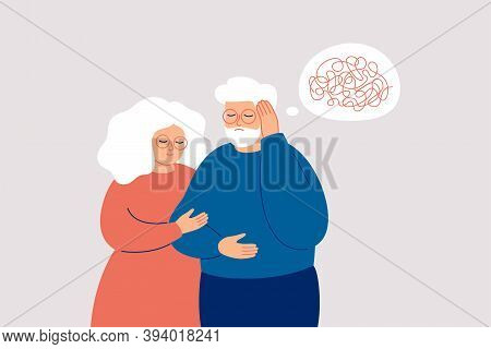Elderly Man With Dementia Needs Help. Mature Couple Supports Each Other In The Fight With Amnesia An