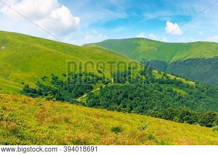 Alpine Scenery Of Carpathian Mountain Ridge Borzhava. Stunning Views On A Windy Summer Day. Clouds O