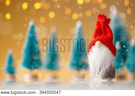 Cute Christmas Gnome Is Sitting And Waiting For His Presents For Christmas
