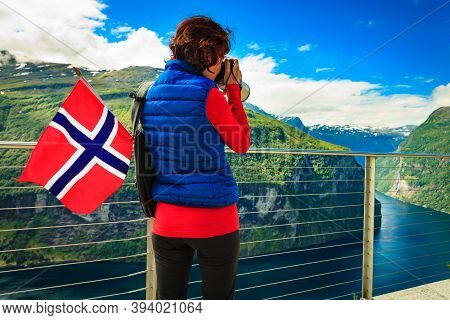 Tourism Holidays Picture And Traveling. Woman Tourist Enjoying Fjord Landscape Geirangerfjord From O