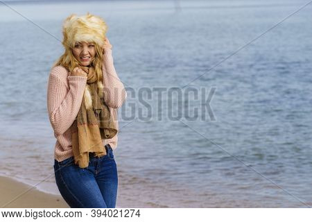 Woman Wearing Warm Stylish Autumnal Outfit With Furry Big Hat Yet Feeling Cold. Female Having Chills