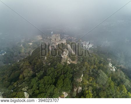 Aerial view of Castelo dos Mouros or Moorish Castle in fog, Sintra, Portugal