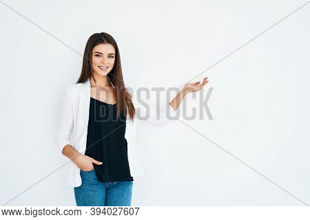 Beautiful Smiling Woman Holding And Presenting Copy Space On Her Palm Isolated On White Background.