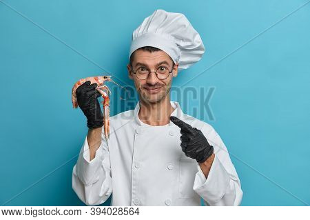 Positive Chef Cook Points At Boiled Lobster, Wears Rubber Black Gloves, White Uniform, Prepares Sea