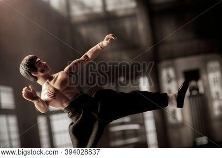 NOV 8 2020: Scene with martial arts legend Bruce Lee practicing Jeet Kune Do in a dojo studio setting - Mego Corporation action figure