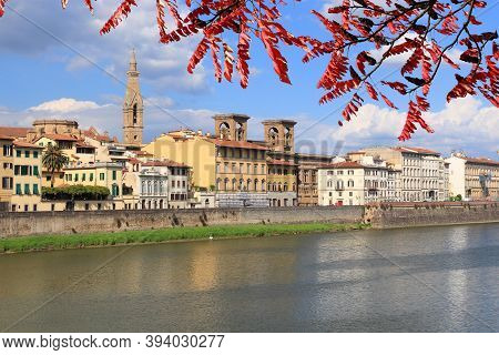 Florence, Italy - Old Town Cityscape Of Riverfront. Autumn Leaves.