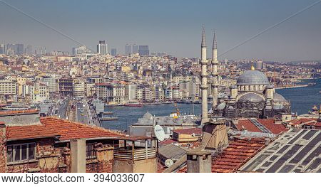 Istanbul, Turkey - March 25, 2019: Touristic sightseeing ships in Golden Horn bay of Istanbul and view on Suleymaniye mosque with Sultanahmet district against blue sky and clouds
