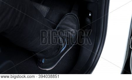 Close Up Images Of Man Driving Car By Pushing Accelerator And Brake Pedal