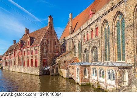 Bruges, Belgium Hospital Of St. John Or Sint-janshospitaal And Canal In The Old Town Of Brugge