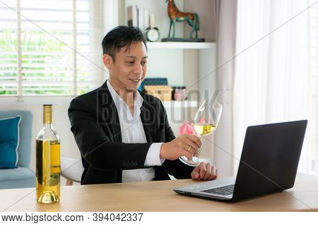 Asian Man Virtual Happy Hour Meeting Party And Drinking White Grape Wine Online Together With His Fr