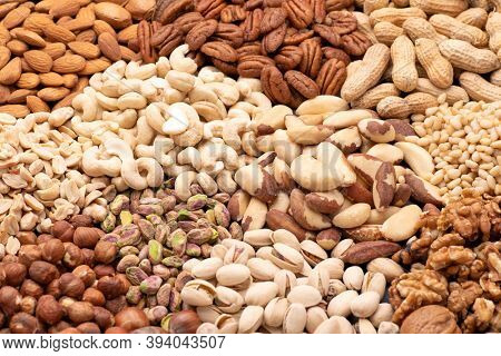 Assortment of various nuts such as cashew nuts, brazil nuts, peanuts, almonds, pecan and other