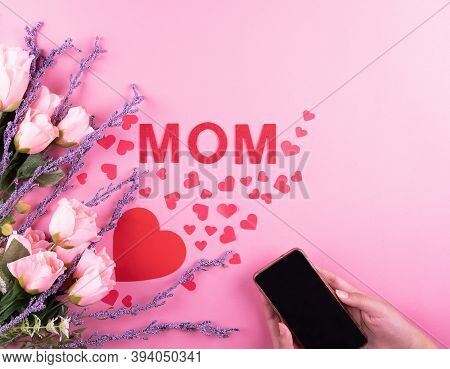 Beautiful Pink Roses, Red Hearts And Mobile With Mothers Day Message . Valentine's Day Concept, Rest