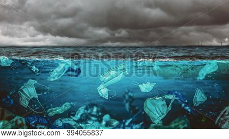 surgical masks and plastic bottles in the sea. environmental risk at the time of covid-19.