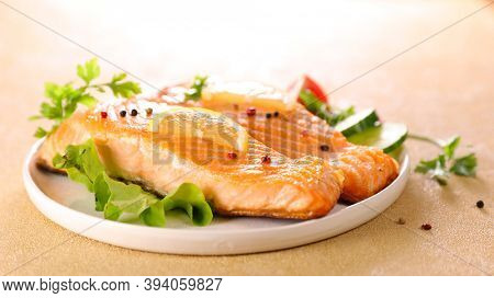 grilled salmon and lettuce in plate
