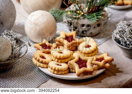 Homemade Traditional Christmas Linz Shortbread Biscuits Cookies With Red Jam On Plate. Trend Wooden