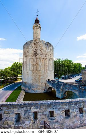 The historic round tower of Constance. Antique walls of the medieval port of Aigues-Mortes. Mediterranean coast of France. The concept of active, historical and photo tourism