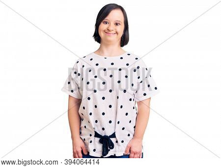Brunette woman with down syndrome wearing casual clothes with a happy and cool smile on face. lucky person.
